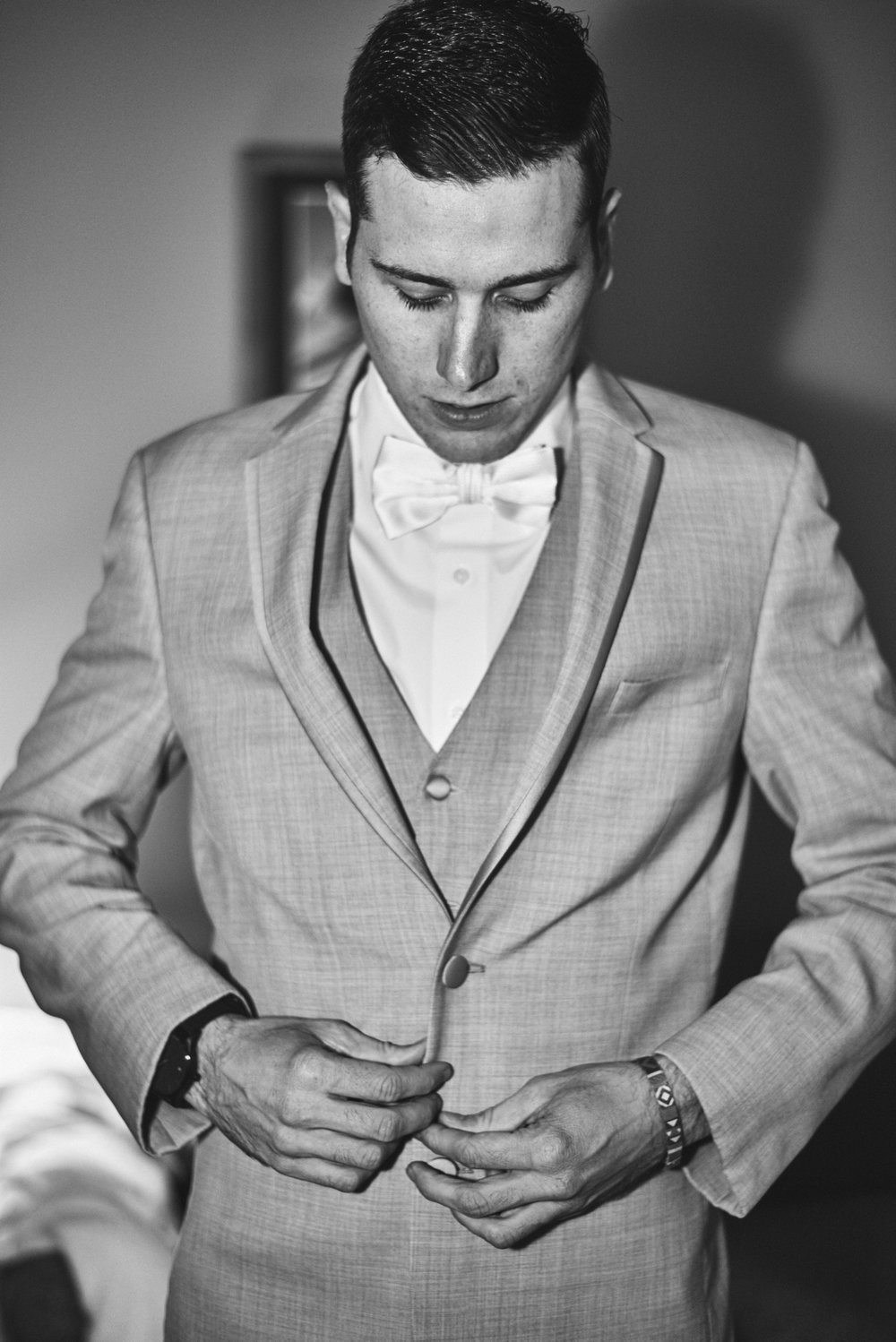 Wedding Photography by Cate Bligh, groom getting ready at Mountain Edge Resort and Spa in Newbury, NH