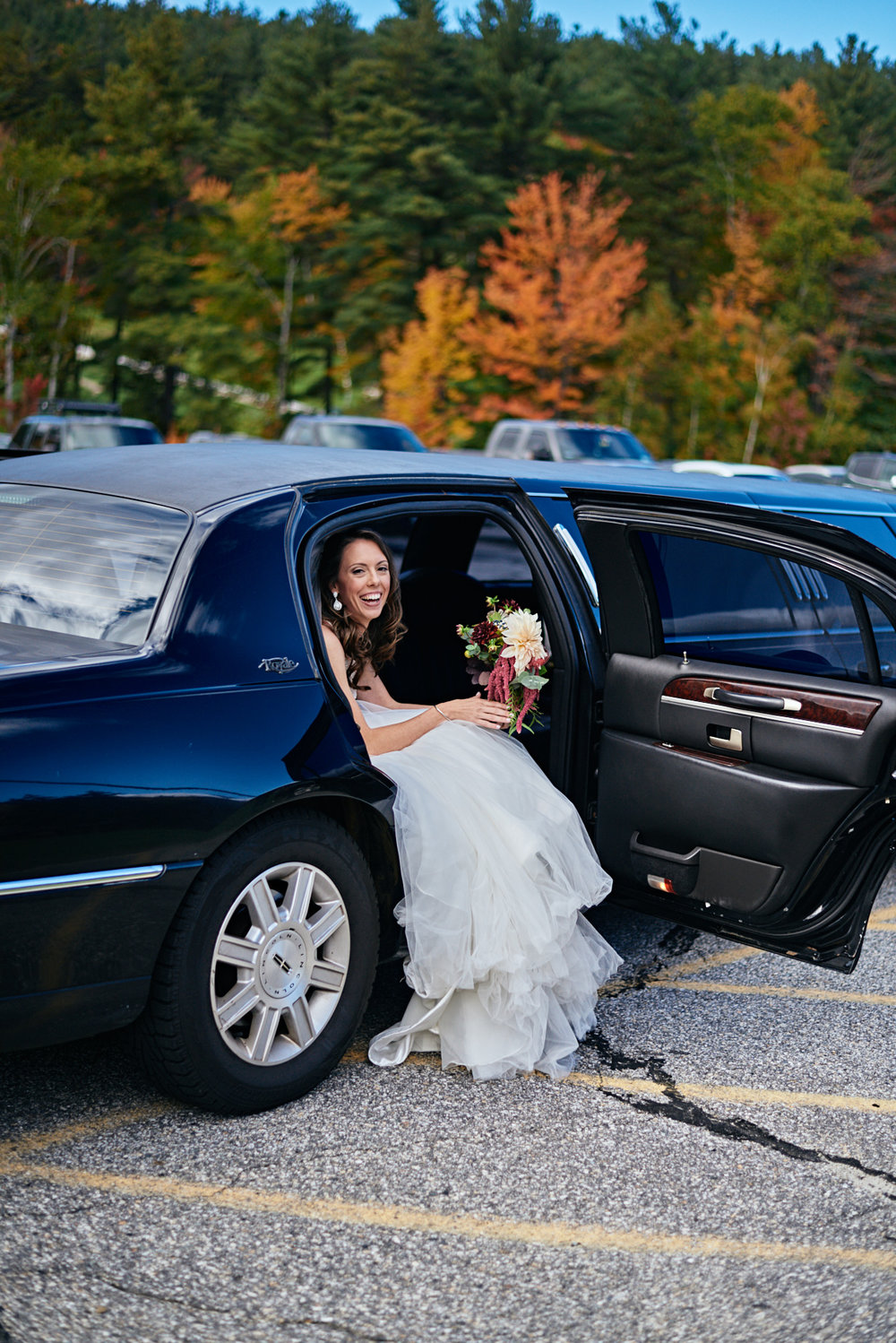 Wedding Photography by Cate Bligh, the bride arrives at Mount Sunapee Resort in Newbury, NH with her father
