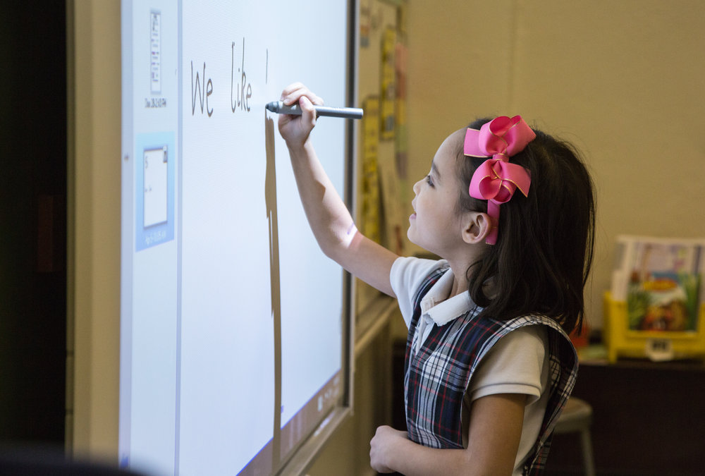Primary school extends from Kindergarten through 4th grade. All students are able experience interactive learning at our smart boards located in every classroom.