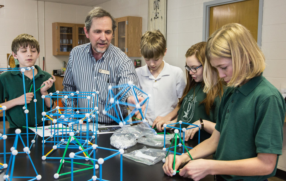 Middle school extends from 5th through 8th grade. Here Mr. Shaver offers hands on experience in our new state-of-the-art science lab.