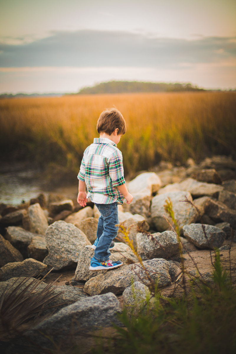 boy walking on rocks / outdoors / savannah ga