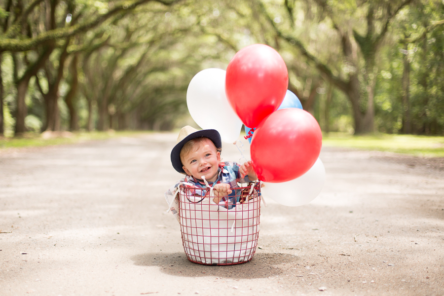 basket of baby and balloons