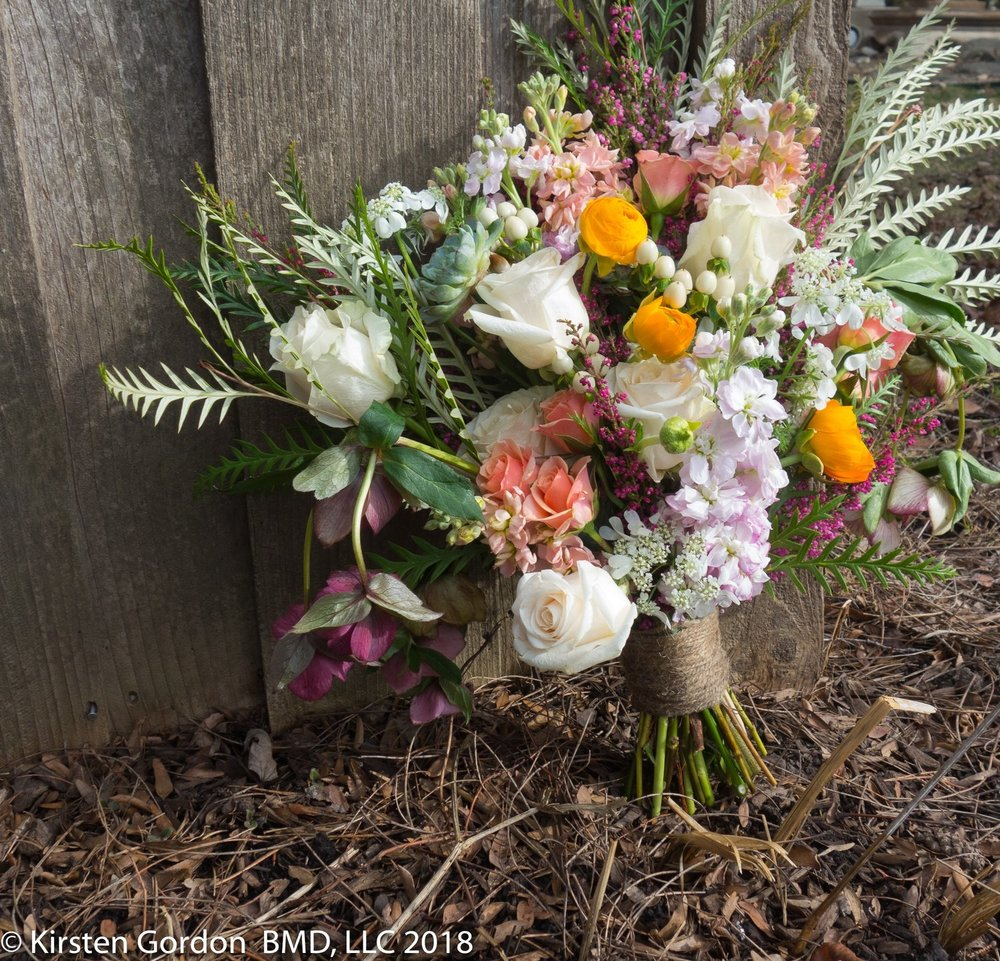 Another shot of the Rustic bridal bouquet outside at the barn - April 2018  This look can be achieved throughout the year with seasonally available accent flowers. Hellebores are done for a while.