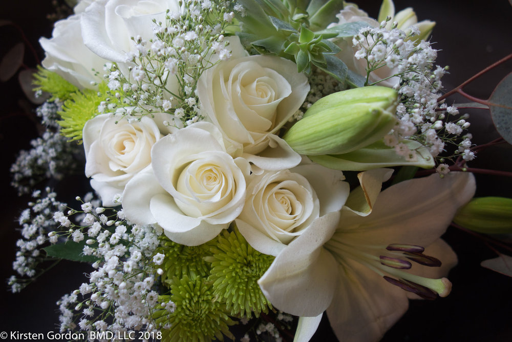 Detail of a simple white & Green bridal bouquet