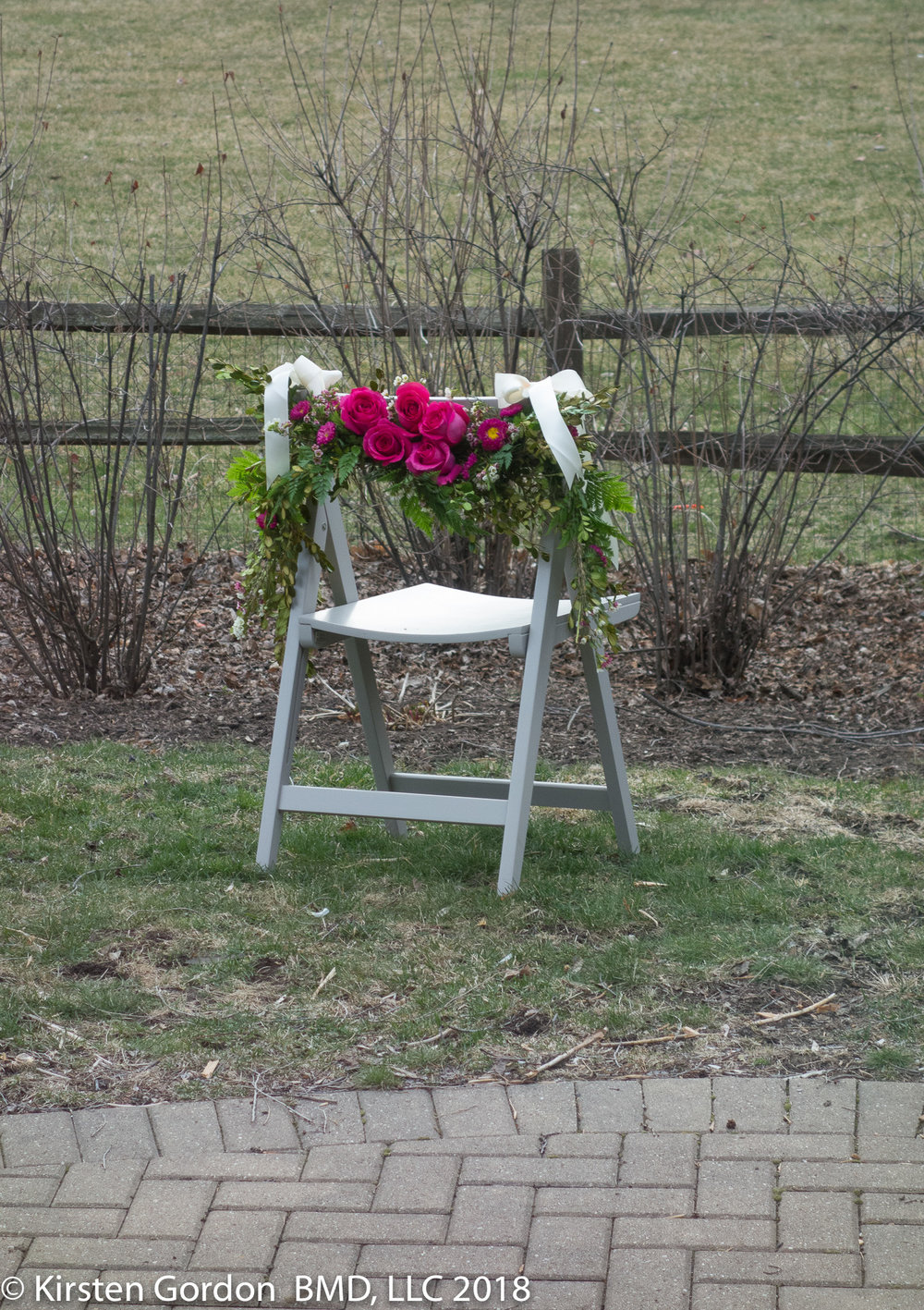 Far Away Shot - Sitting Pretty VIP Wedding Chair  Let us help you choose the right greens and flowers for  POP  at your venue.