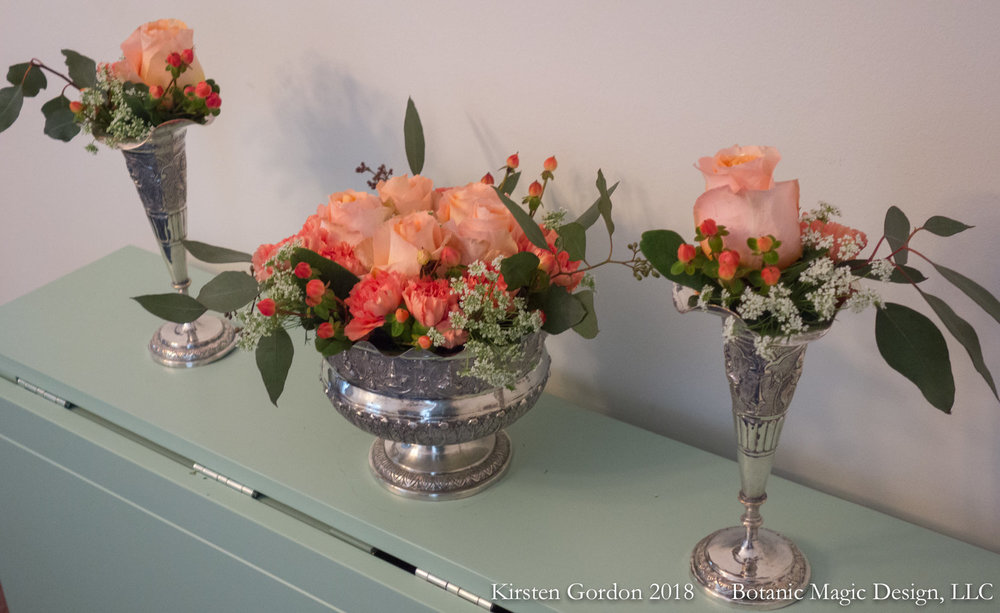"centerpiece and side matching in peach - 13"" Height  This trio was done for a January 2018 party using the client's family silver pieces. a quiet, monochromatic scheme plays up the ornate vessels."