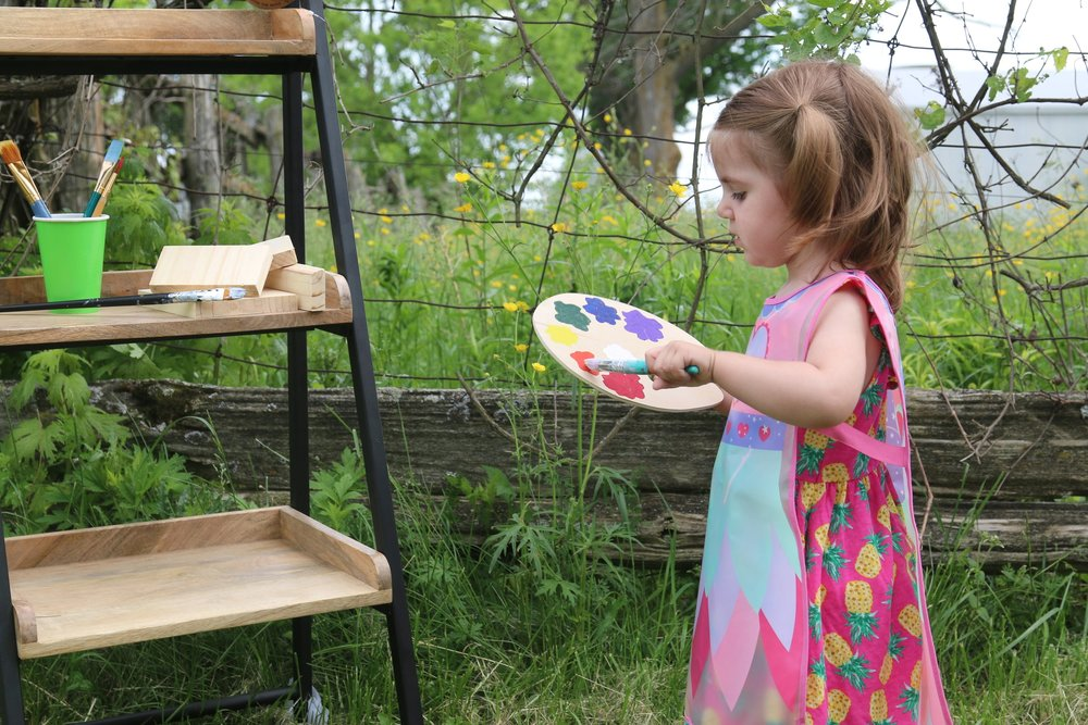 Ava - The Painting Princess  How could Urban Playground finish all it's wooden pieces without the little soul behind the colourful, playfulness of all our designs?  Ava loves holding a paintbrush in her little hand, painting to her hearts content.  She also helps choose and organize all our paint and stain options.