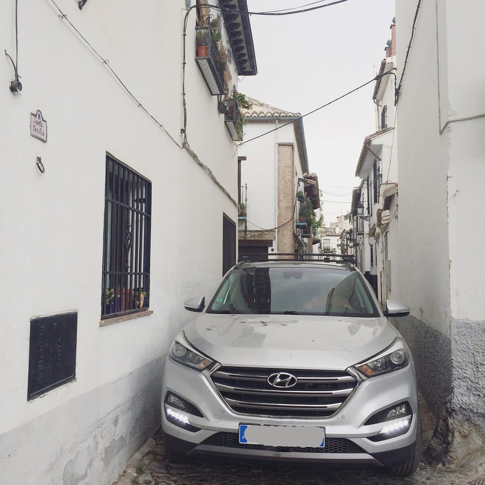 "Our own ""bus"" on the narrow streets of Granada."
