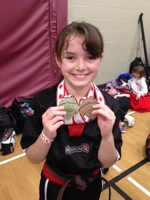 That's one gold in sparring, and one bronze in kata. And a million-dollar smile.