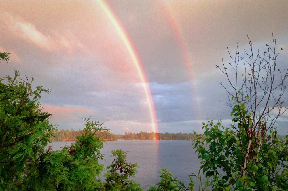 Double rainbow over lake.jpg