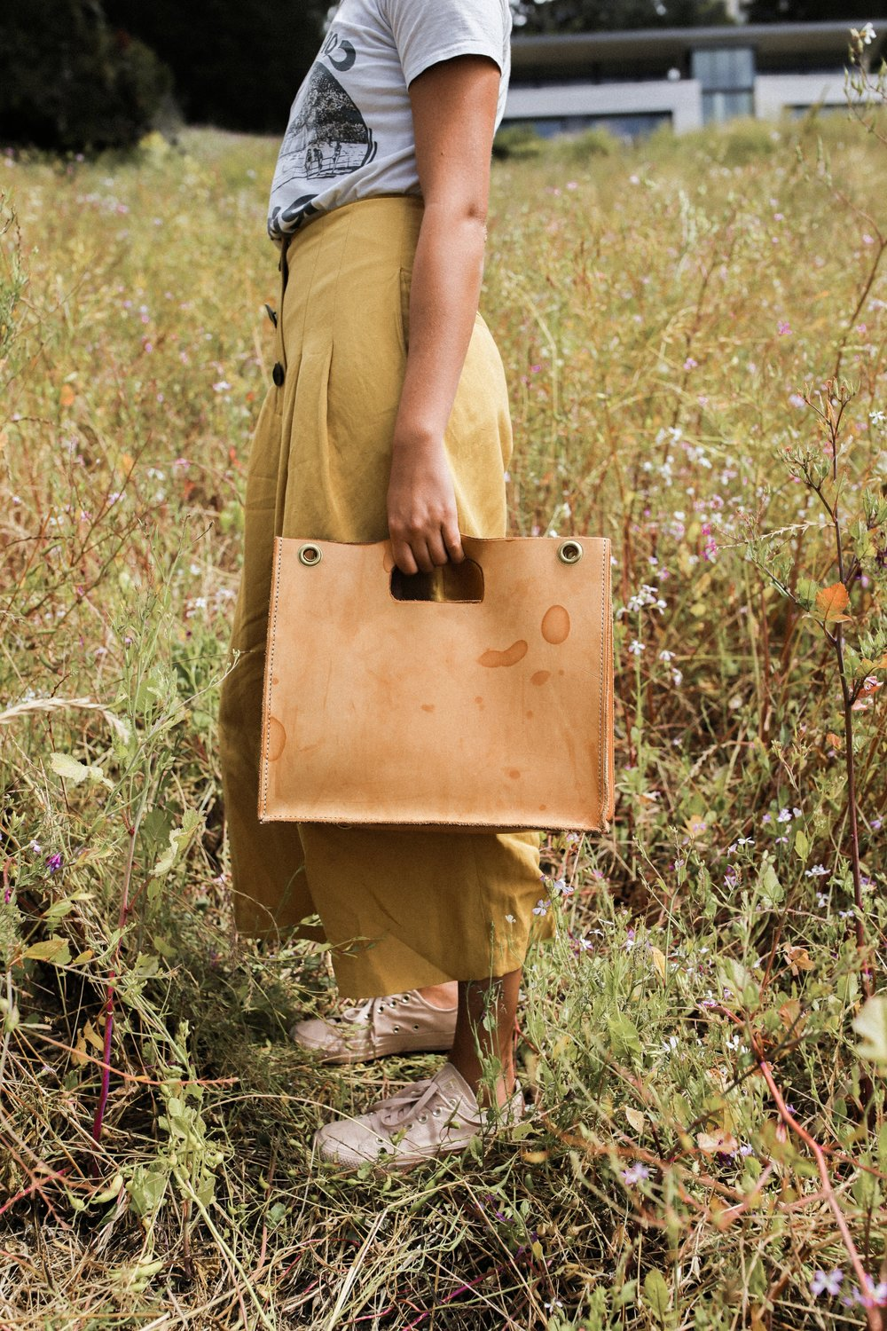 Patina and wear causes the color to darken. This Petite tote has been loved for one year.