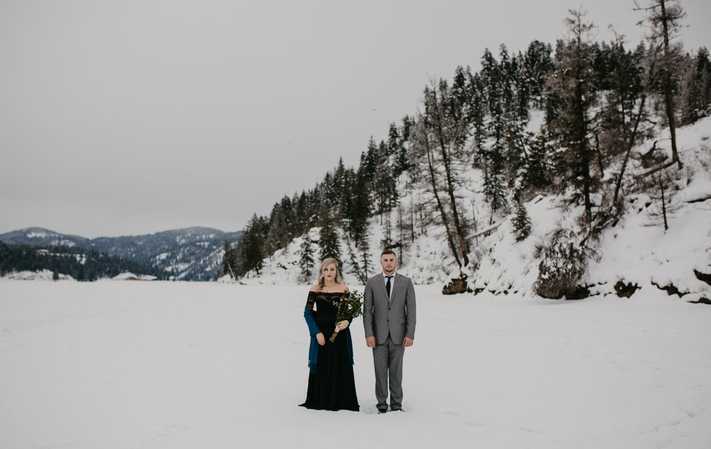 Bride and Groom standing on frozen lake during portrait session