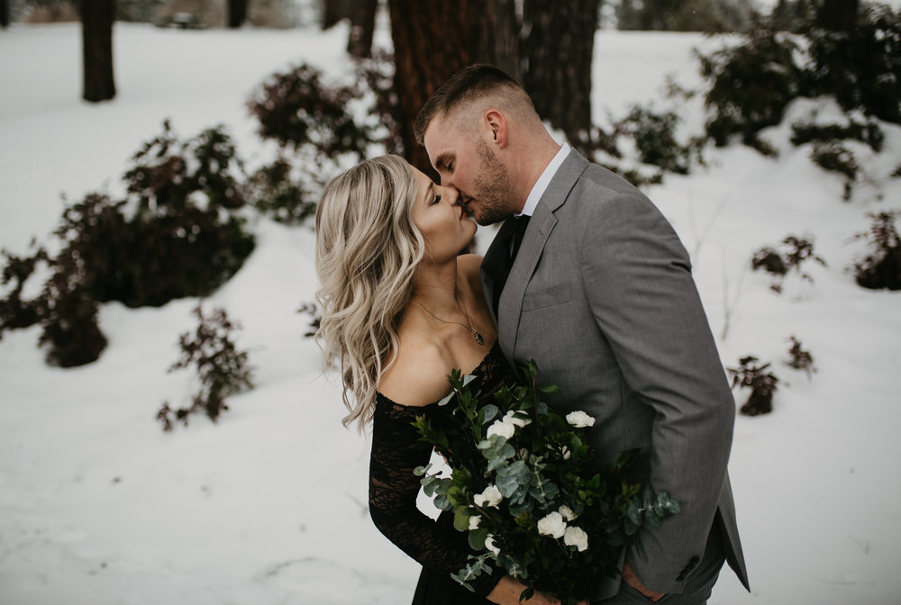 Bride and Groom kissing in the snow in Coeur d Alene Idaho