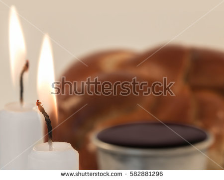 stock-photo-jewish-sabbath-candle-wick-and-flame-close-up-shallow-depth-of-field-blurry-challah-bread-and-and-582881296.jpg