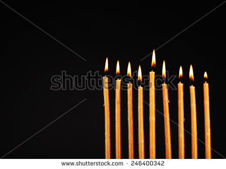 stock-photo-hanukkah-menorah-with-candles-isolated-on-black-246400342.jpg