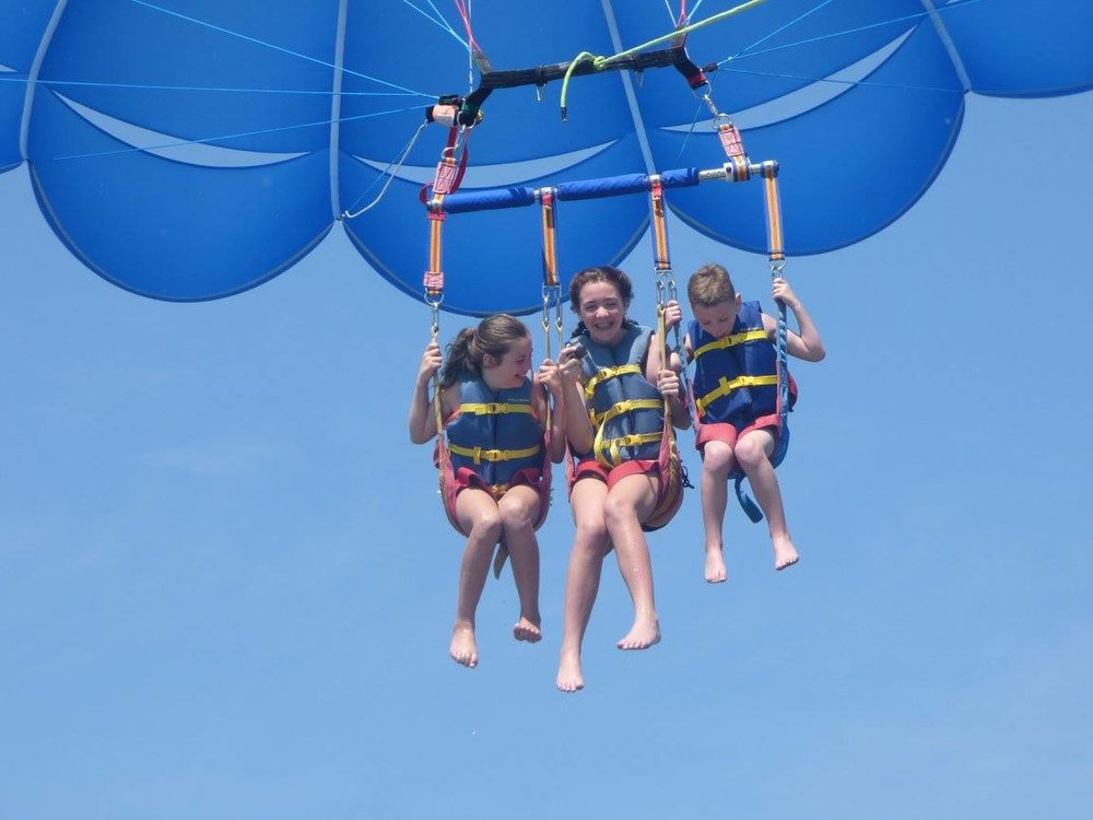 These first-timer's grin ear-to-ear as they enjoy parasailing over Hilton Head Island.