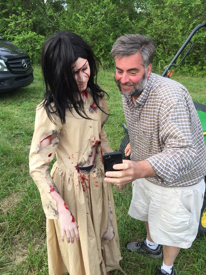 Actor Genevive, checking out a phone shot by publicist Scott Fowler on set.
