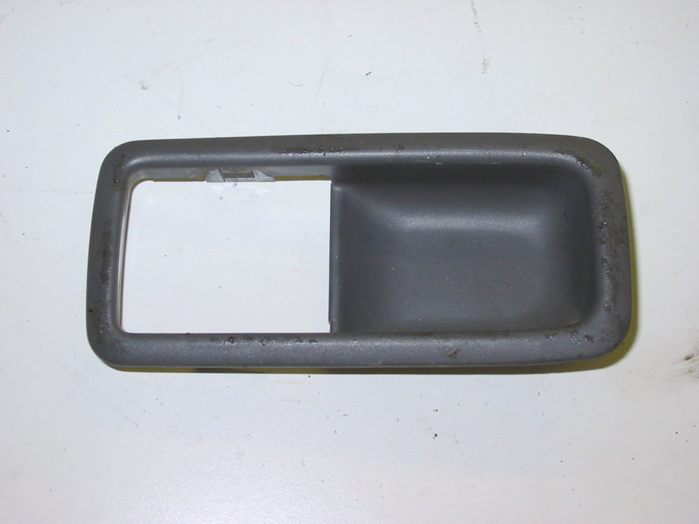 Trim, interior, remote handle (1990-1994 Legacy)