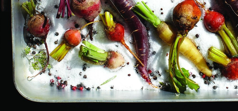 Root vegetables in a pan with sea salt