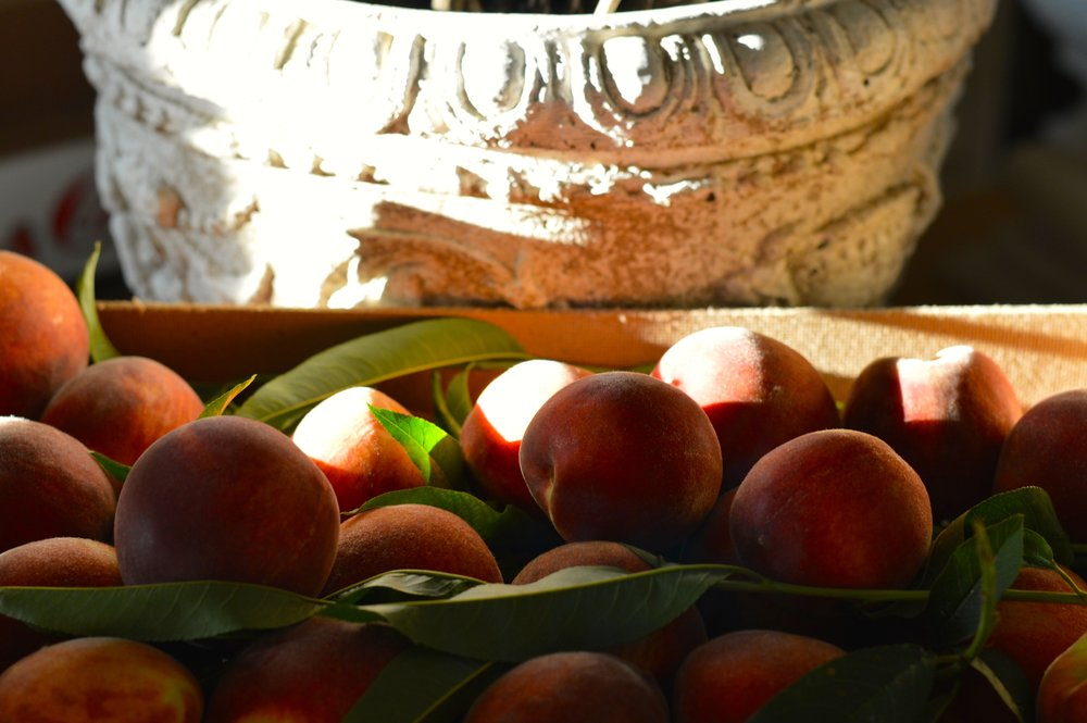 Bowl of fresh organic peaches from a Sicilian market