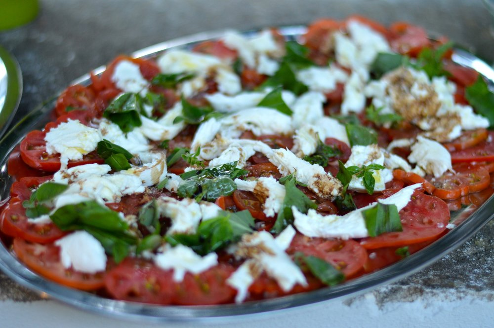 Colorful tomato and basil salad made from Sicily's freshest ingredients
