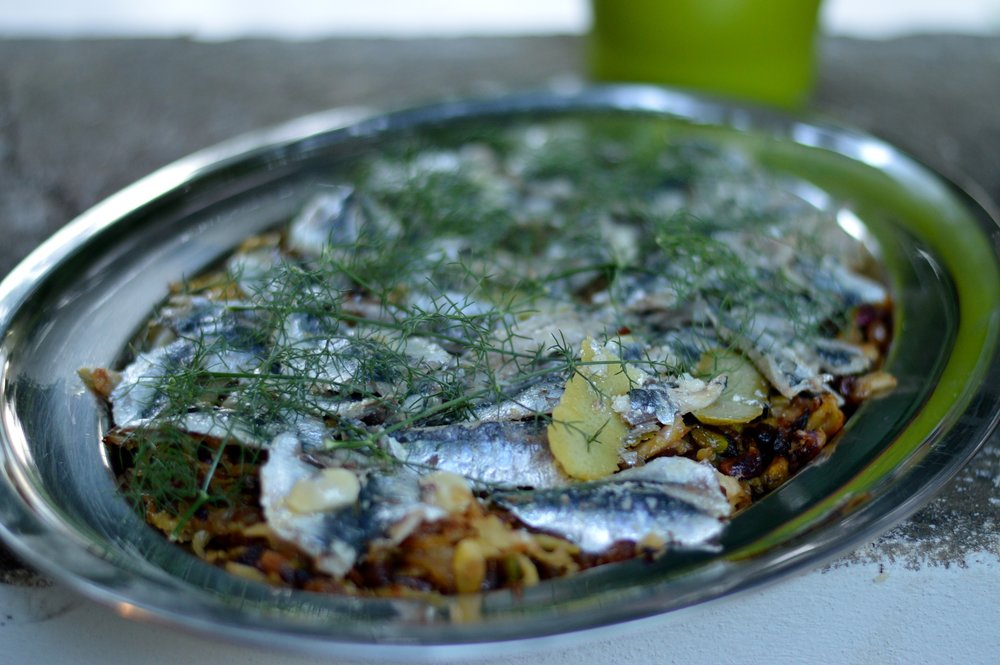 Platter of fish with fresh herbs