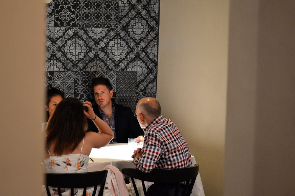 Seamus Mullen has dinner with guests of Chef On Wheels Bike Tour in Sicily