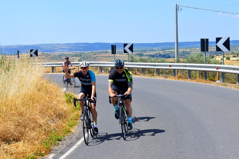 Seamus Mullen cycles with guests on Duvine's Chef On Wheels Bike Tour in Sicily