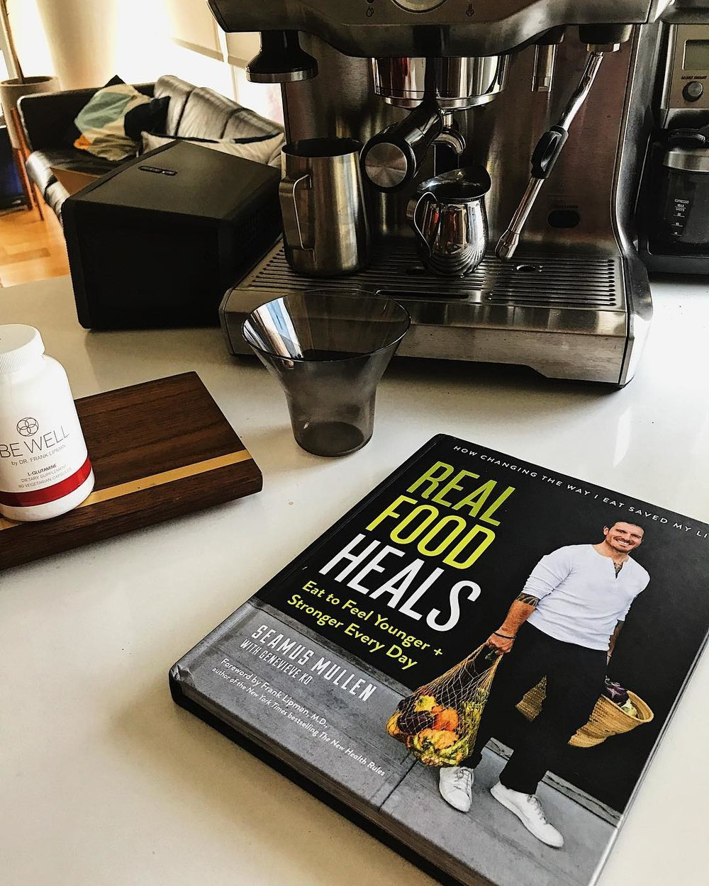 "the book ""Real FOod Heals"" on a kitchen counter"