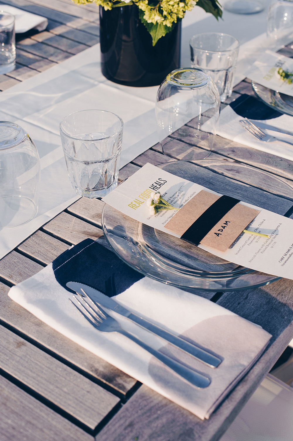 Rooftop dinner place setting with menu by Seamus Mullen