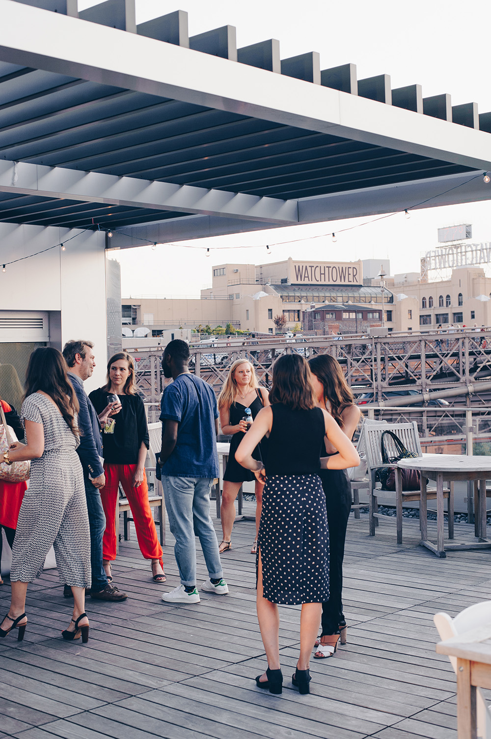Guests gather at rooftop dinner celebrating Seamus Mullen's book Real Food Heals