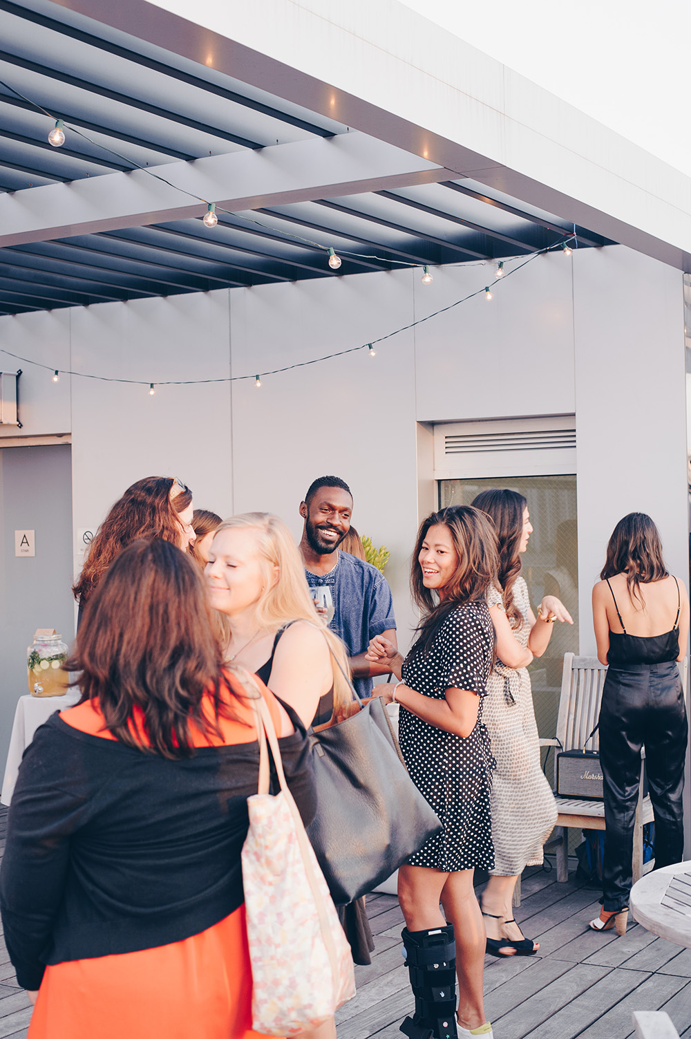 Guests mingle at rooftop dinner celebrating Seamus Mullen's book Real Food Heals