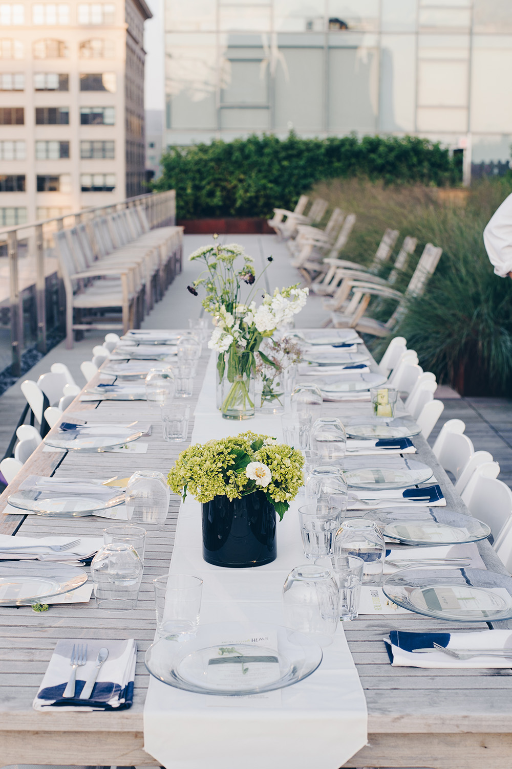Dinner on the Roof table setting with wild flower centerpieces