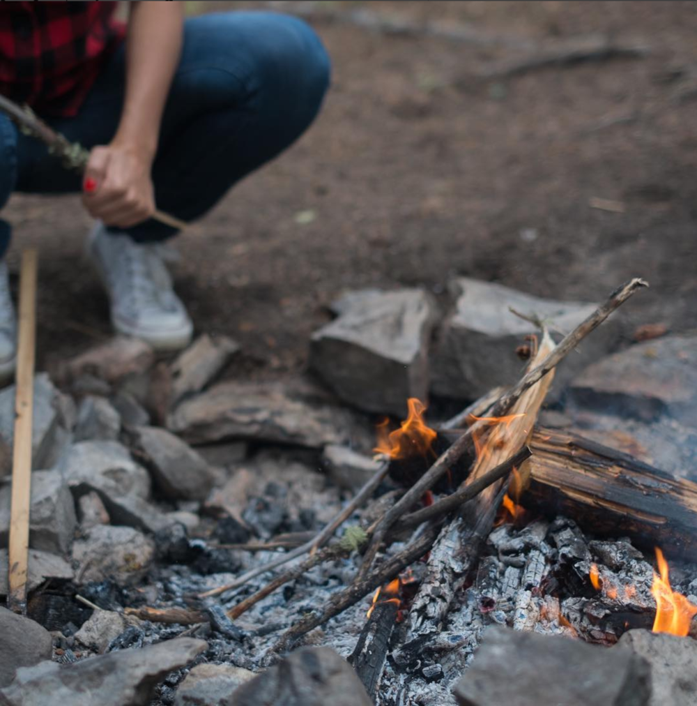 Millennial starting a camp fire