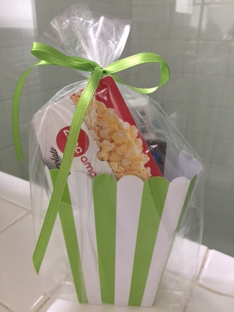 A Movie Basket is a great gift. Movies are a fun summer activity( ac!) and you can play around with different candies, gourmet popcorn and gift cards. Make it an at home movie basket with a cute throw, Netflix gift card and microwave popcorn.