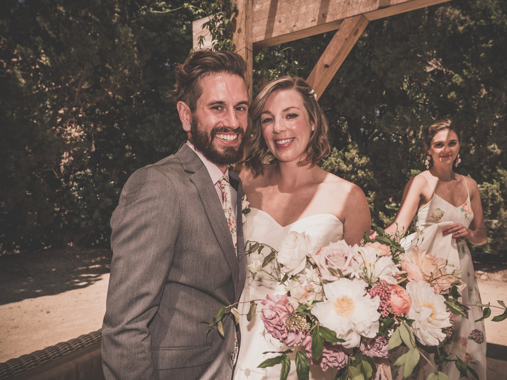 GROOM, BRIDE & THE PRETTIEST BOUQUET I EVER DID SEE!