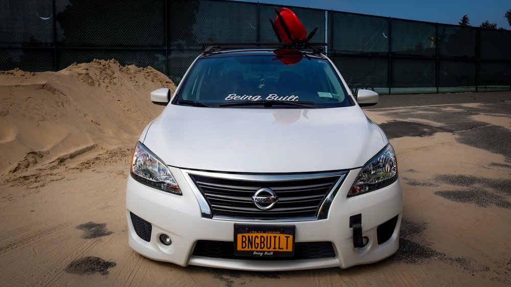 Mods/changes from OEM to the Sentra:  Airforce suspension bags and management, AG Wheels, AEM short ram intake, muffler delete, custom trunk set up with wood flooring and sub, Vinyl wrapped roof, HID lights, Custom tow strap holder, Sony touch screen double din receiver with Apple car play, VIP rear center table, Color matched eyelids.
