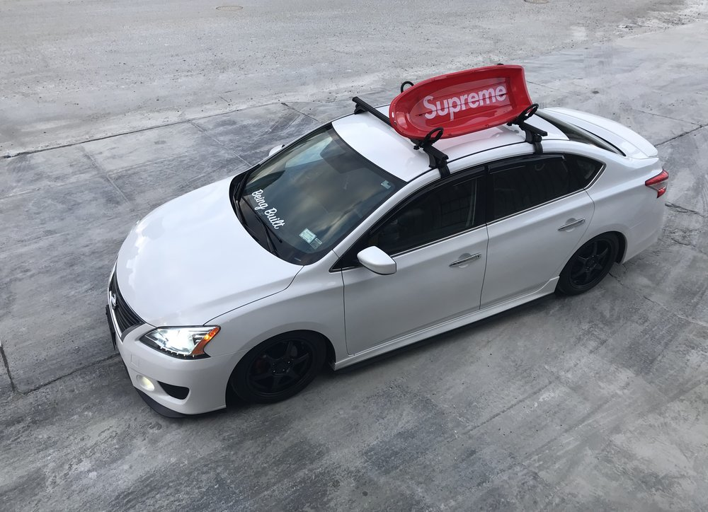So why the SUPREME board:  So I have been heavy influenced by streetwear since I was in middle/early high school. When I saw that board was being released in the winter '18 collection I envisioned it on the car and had to have it. I think it peaks people's interest and have seen people walk over to it and take pictures just because of the board.