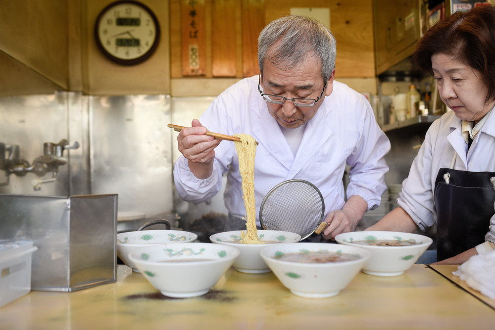 Ramen Master carefully placing the noodles in the bowl