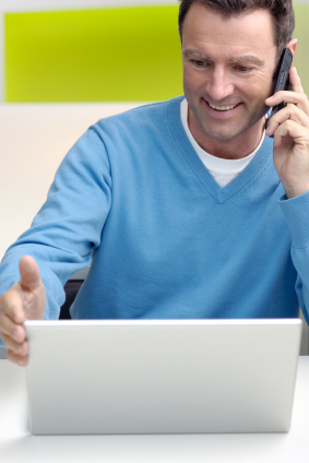 businessman casual on phone and laptop.jpg