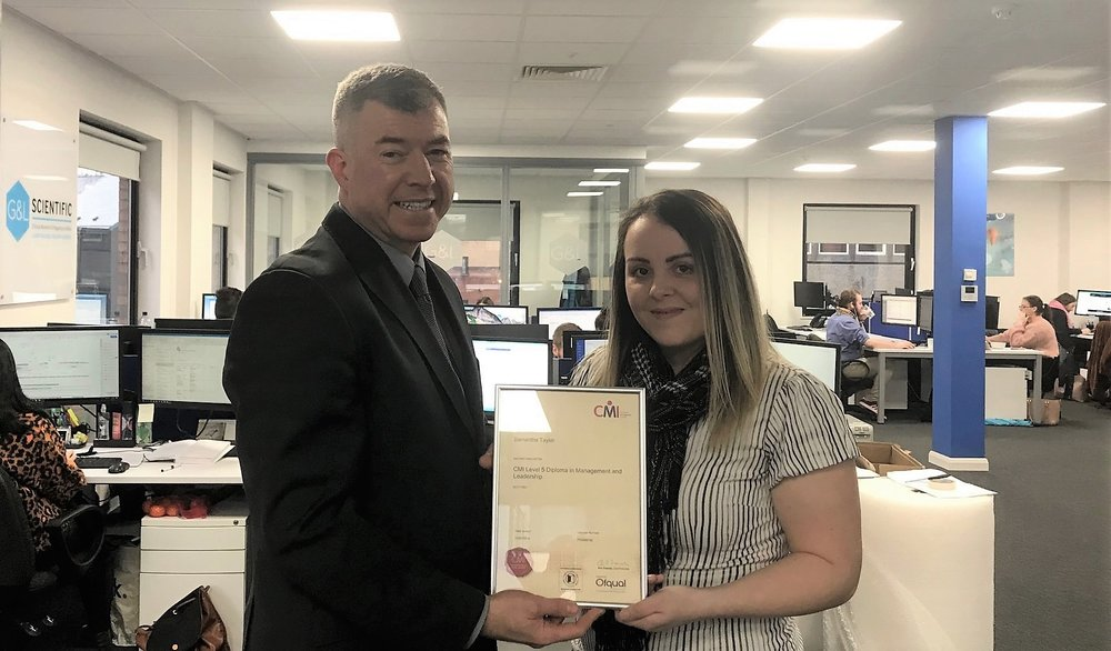 Martin Rice (CEO Next Level Impact) presents Samantha Taylor (Senior Director Client Services, G&L Scientific) with her Level 5 Diploma in Management and Leadership.