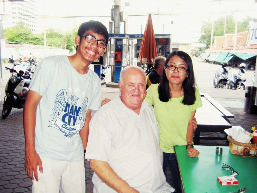 My brother and some friendly man we met and chatted with while having lunch at Pattaya