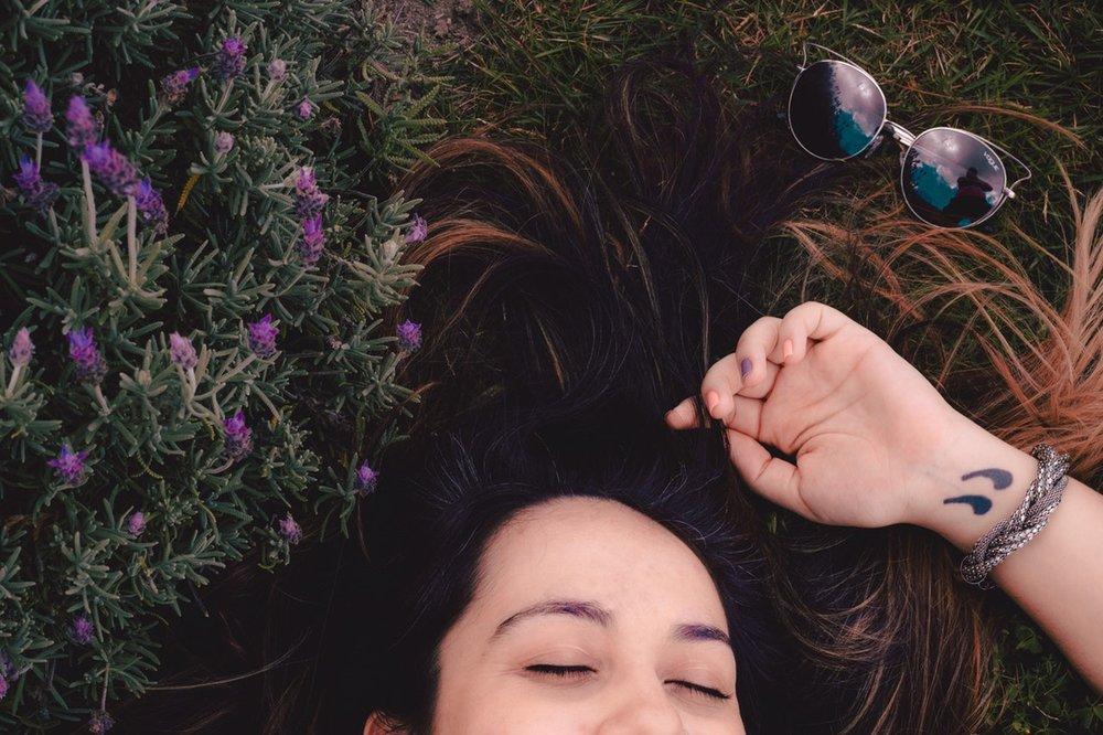Credit:https://www.pexels.com/photo/woman-lying-on-flower-field-744766/