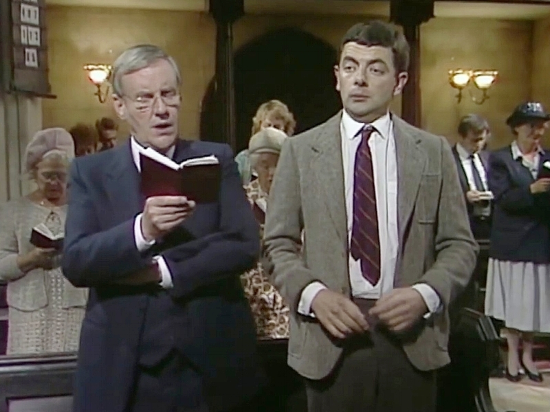 """Mr. Bean - Ada nggak, ya, yang belum pernah nonton sitkom ini? Mr. Bean seperti tidak ada bosannya menghibur di televisi sejak saya kecil sampai sekarang (Disney Channel still put it on screen occasionally). Dan memang tingkah konyolnya tokoh yang diperankan Rowan Atkinson ini nggak ada matinya, sih! Sehingga meskipun sudah hapal di luar kepala beberapa plot episode-nya, saya masih saja tergelak tiap kali menontonnya. Favorit saya adalah scene ngantuk di gereja (remember when he belted out an off-key """"hallelujah""""? LOL).Image credit: Beturt"""