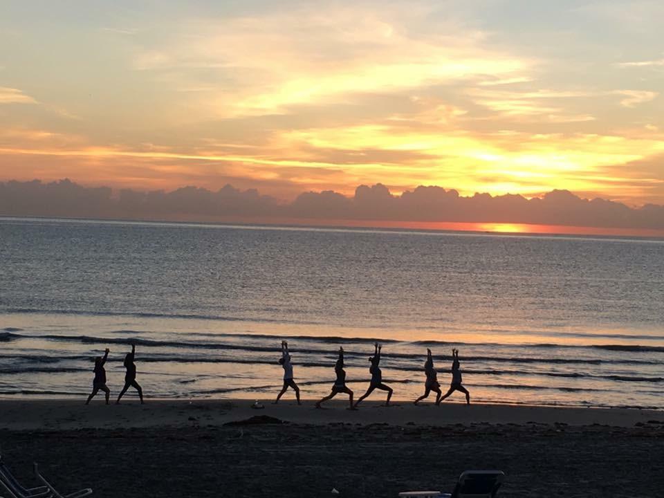 Sunrise yoga on the beach.