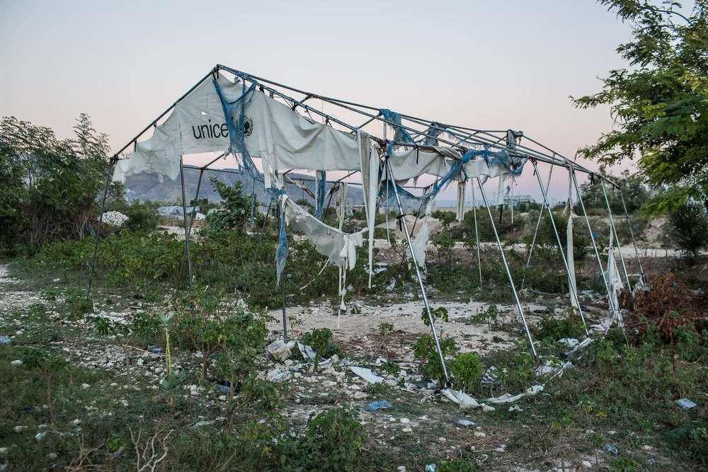 A tent donated by UNICEF which was formerly used as a church stands in tatters at the Corail-Cesselesse camp for people displaced by the 2010 earthquake on Saturday, December 20, 2014 in Port-au-Prince, Haiti. The camp is home to tens of thousands of people, for most of whom there is no work or easy access to the center of town, some 18 kilometers away.