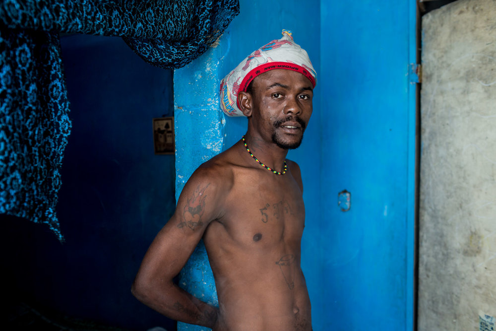 Emmanuel Deus, a musician, poses for a portrait at his home on Thursday, December 18, 2014 in Port-au-Prince, Haiti. Fort National was among the hardest hit areas of Port-au-Prince in the 2010 earthquake, but rebuilding has been slow to non-existent. Residents still mostly lack electricity and running water.