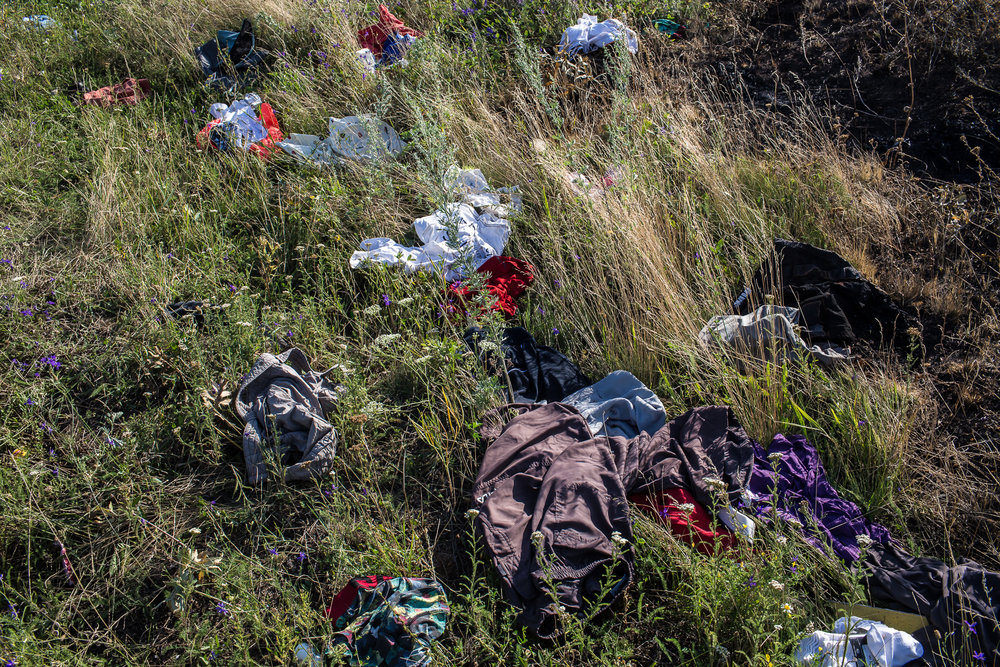 Clothing from the crash of Malaysia Airlines flight MH17 is strewn in the grass at the crash site on July 20, 2014 in Grabovo, Ukraine. The flight was traveling from Amsterdam to Kuala Lumpur when it crashed killing all 298 on board including 80 children. The aircraft was allegedly shot down by a missile and investigations continue over the perpetrators of the attack.
