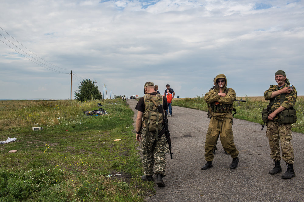 Pro-Russia rebels guard the site of the crash of Malaysia Airlines flight MH17 on July 19, 2014 in Grabovo, Ukraine. Malaysia Airlines flight MH17 was travelling from Amsterdam to Kuala Lumpur when it crashed killing all 298 on board including 80 children. The aircraft was allegedly shot down by a missile and investigations continue over the perpetrators of the attack.