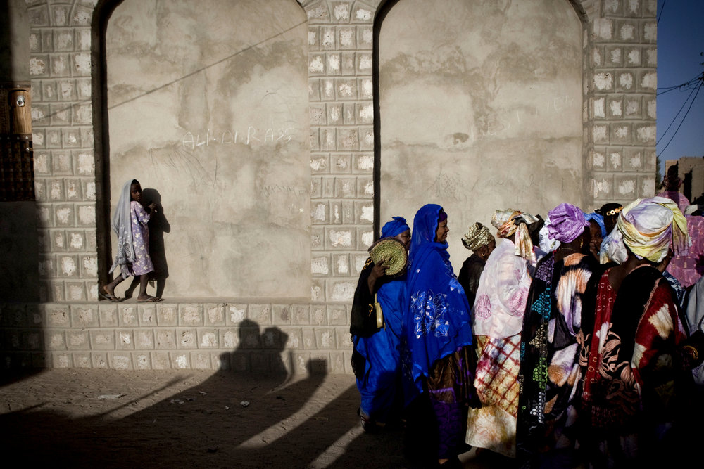 Women gather in the streets of Timbuktu, Mali on a Sunday afternoon to celebrate a three day wedding. by Katie Orlinsky.